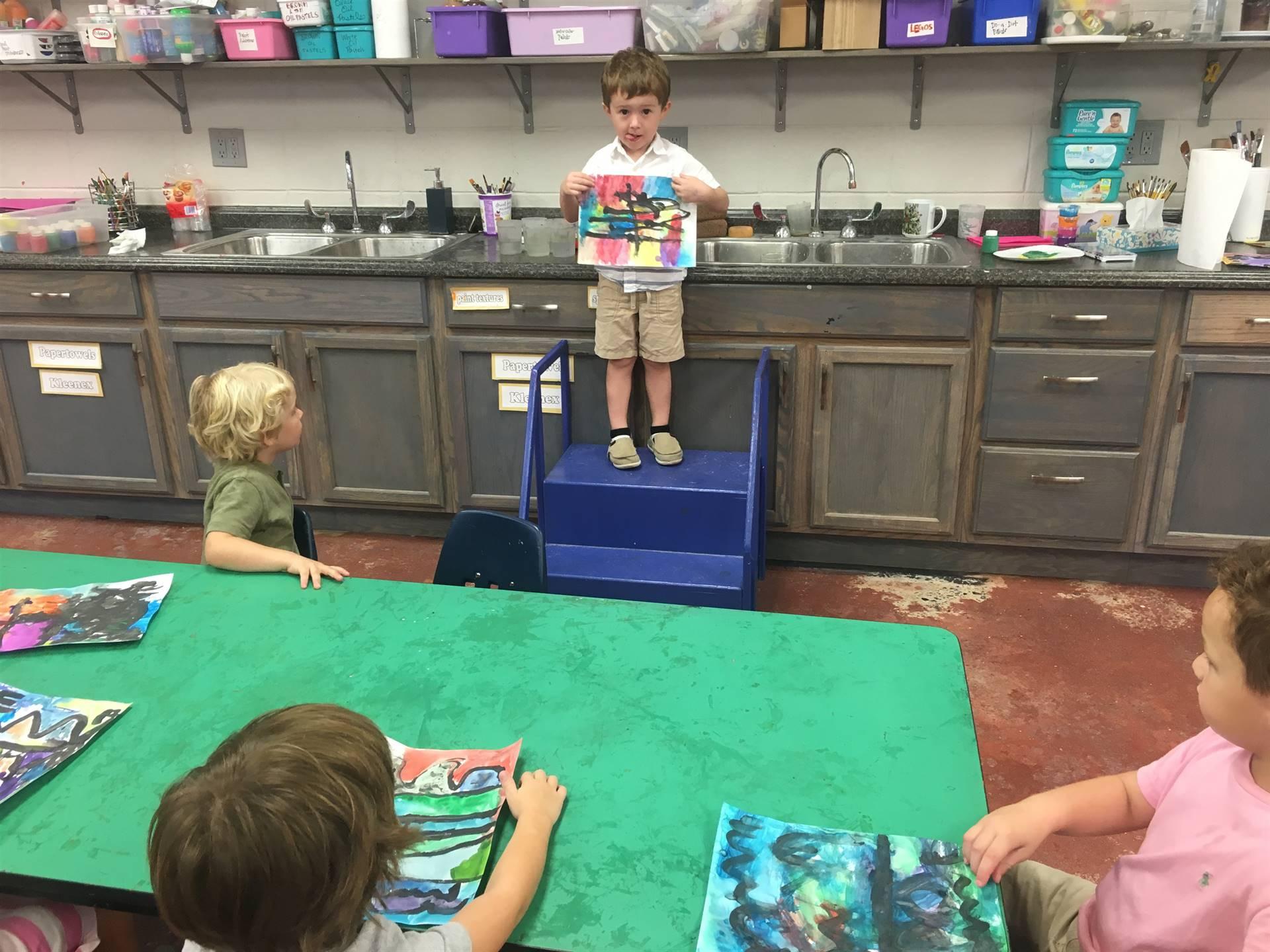 Evan presenting his masterpiece