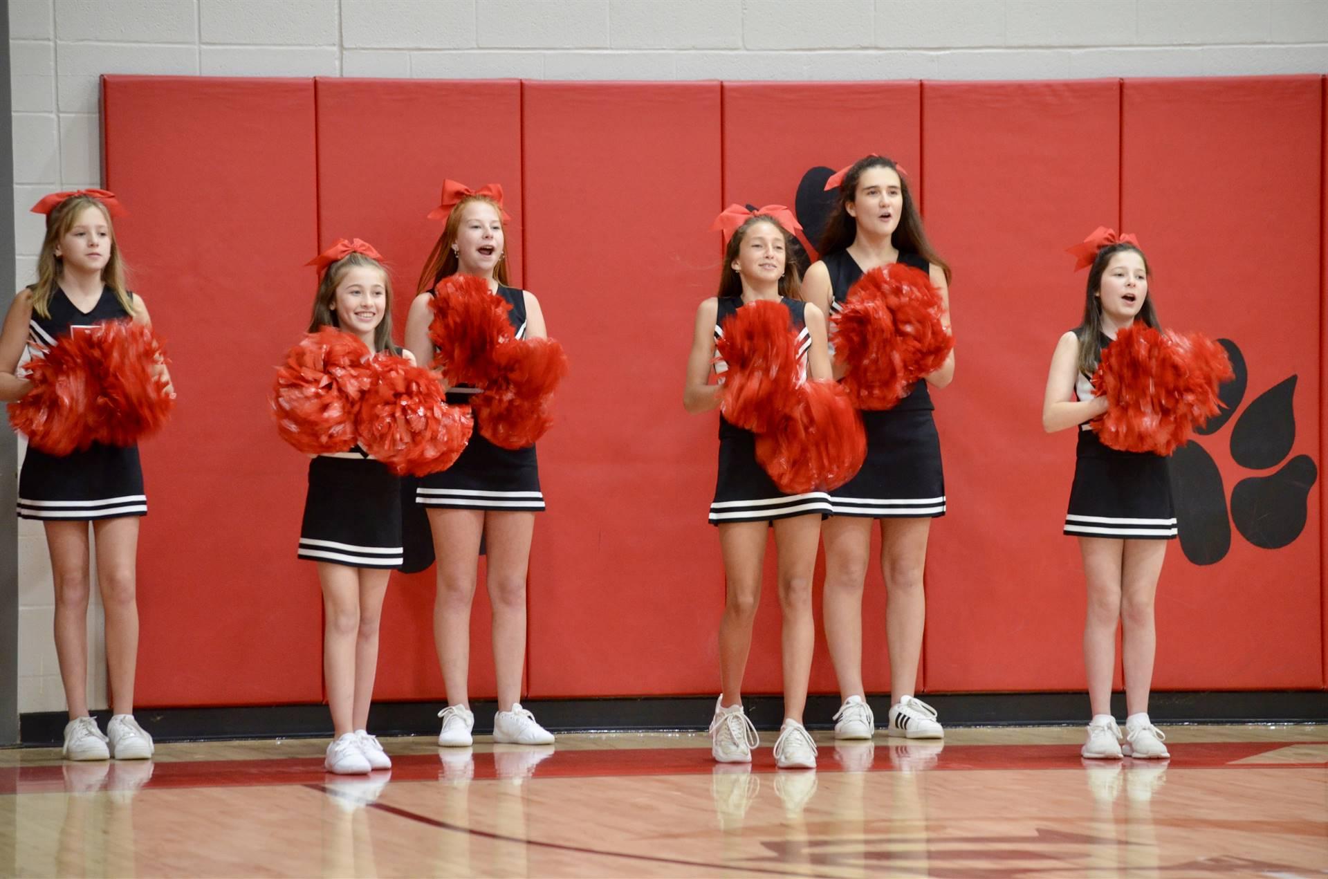 cheering at basketball game